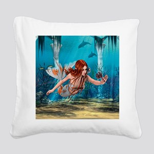 Mermaid holding Sea Lily Square Canvas Pillow