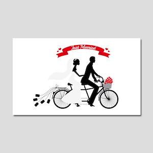 Just married bride and groom on tandem bicycle Car