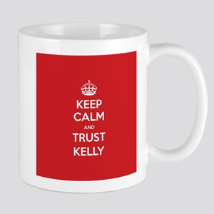Trust Kelly Mugs