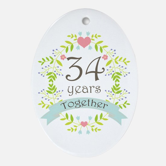 34th Anniversary flowers and heart Ornament (Oval)