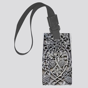 Detail of the carving on Caedmon Large Luggage Tag