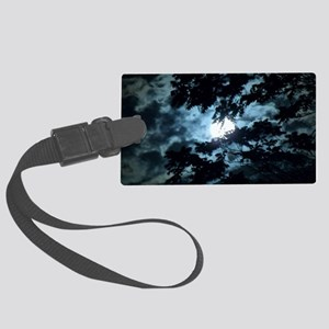 Moon through the trees. Large Luggage Tag