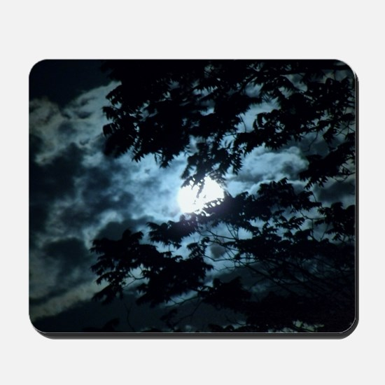 Moon through the trees. Mousepad