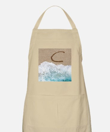 LETTERS IN SAND C Apron