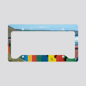 Brightly coloured beach huts  License Plate Holder