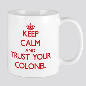 Keep Calm and trust your Colonel Mugs