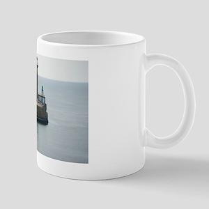 Fishing boat and pier Mug