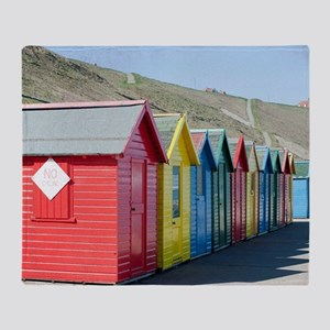 Beach huts at Whitby Sands Throw Blanket