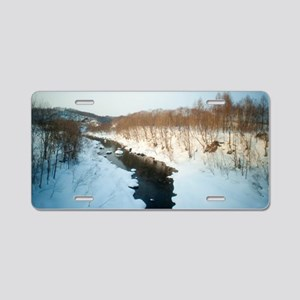 Stream flowing through snow Aluminum License Plate
