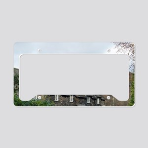 Row of quaint stone cottages  License Plate Holder