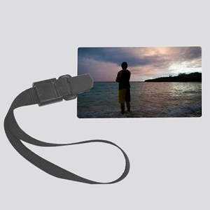 Man watching an ocean sunset Large Luggage Tag