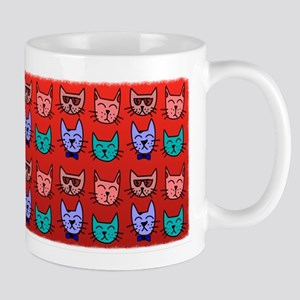 Cat faces on red Mug
