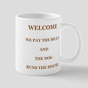 The Dog Runs The House Mugs
