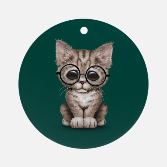 Cute Tabby Kitten with Eye Glasses on Teal Blue Or