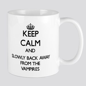 Keep calm and slowly back away from Vampires Mugs