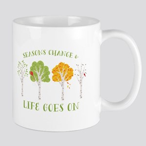 Seasons change & life goes on Mugs