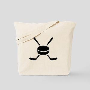 Crossed hockey sticks puck Tote Bag