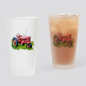 Red Tractor in the Grass Drinking Glass