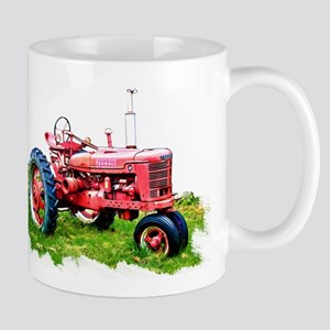 Red Tractor in the Grass Mugs