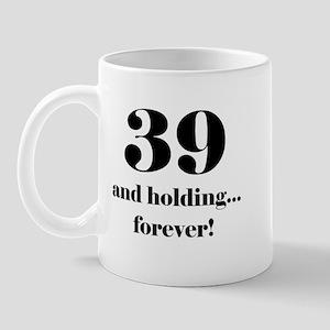 39 & Holding Mug