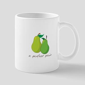a perfect pair Mugs