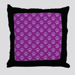 Puppy paw prints on purple background Throw Pillow