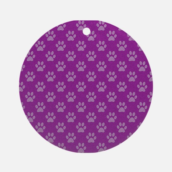 Puppy paw prints on purple background Ornament (Ro