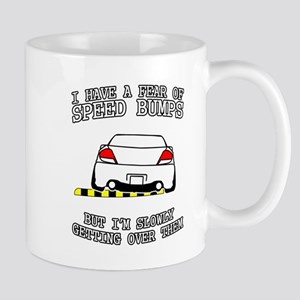 Fear Of Speed Bumps Mugs