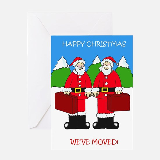 We've moved, couple in Santa outfit Greeting Cards