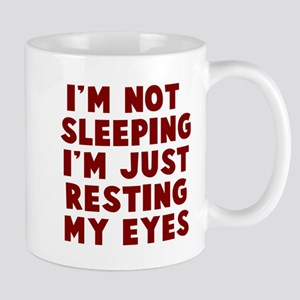 resting eyes Mugs
