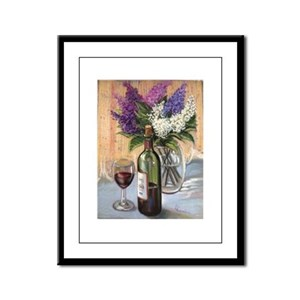 Glass of wine and lilac Framed Panel Print