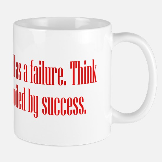 Unspoiled By Success Mugs