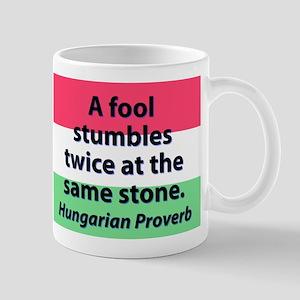 A Fool Stumbles Twice Mugs