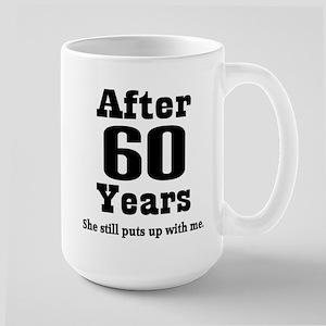 60years_black_she Mugs