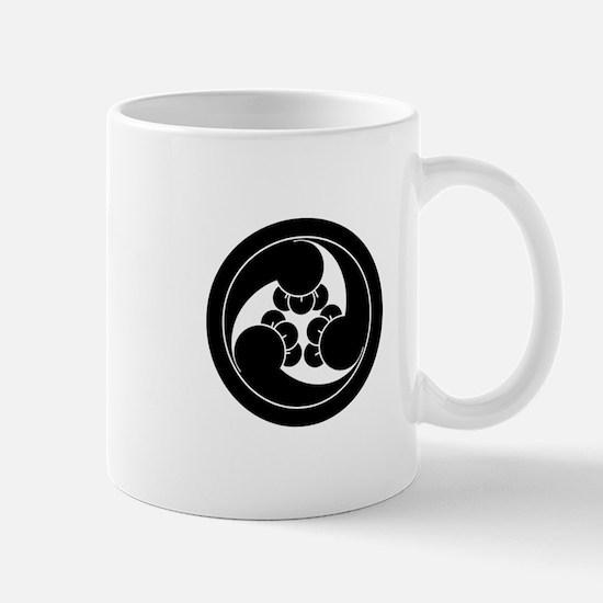 Three clockwise clove swirls in circle Mug