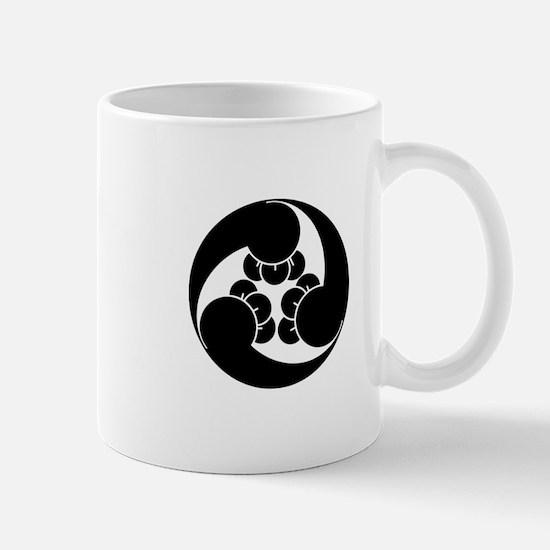 Three clockwise clove swirls Mug
