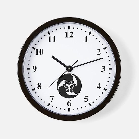 Three clockwise clove swirls Wall Clock