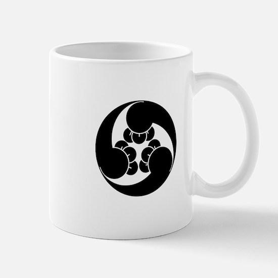 Three counterclockwise clove swirls Mug