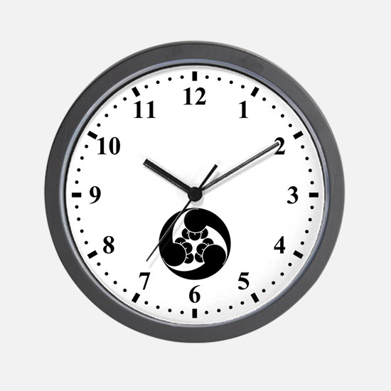 Three counterclockwise clove swirls Wall Clock