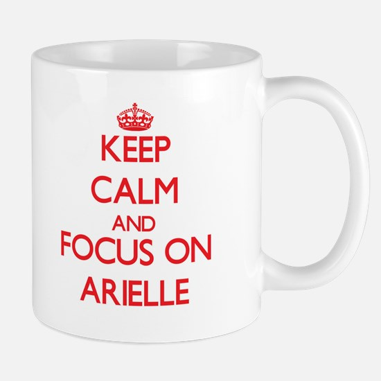 Keep Calm and focus on Arielle Mugs