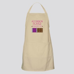 Accordion player powered by chocolate Apron
