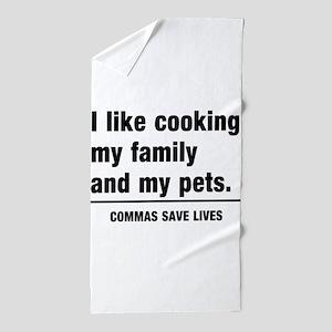 Commas save lives Beach Towel