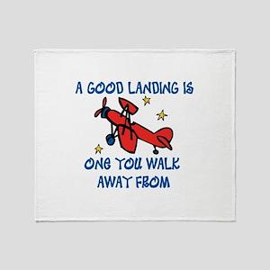 A Good Landing Throw Blanket