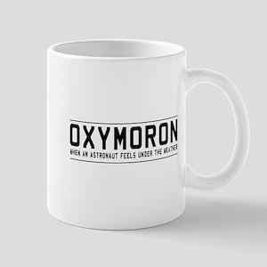 Oxymoron astronaut Mugs