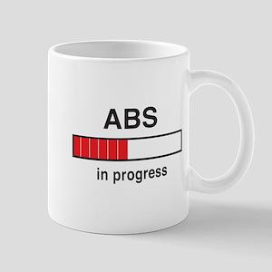 Abs in progress Mugs