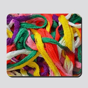 Colorful strands of yarn Mousepad