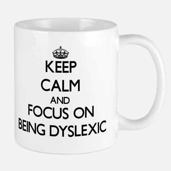Keep Calm and focus on Being Dyslexic Mugs