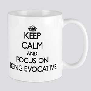 Keep Calm and focus on BEING EVOCATIVE Mugs