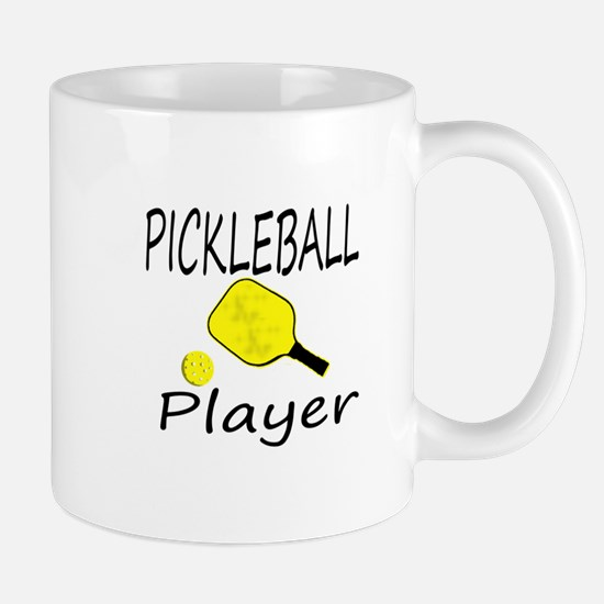 Pickleball player with paddle and ball Mugs