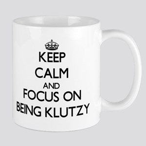 Keep Calm and focus on Being Klutzy Mugs